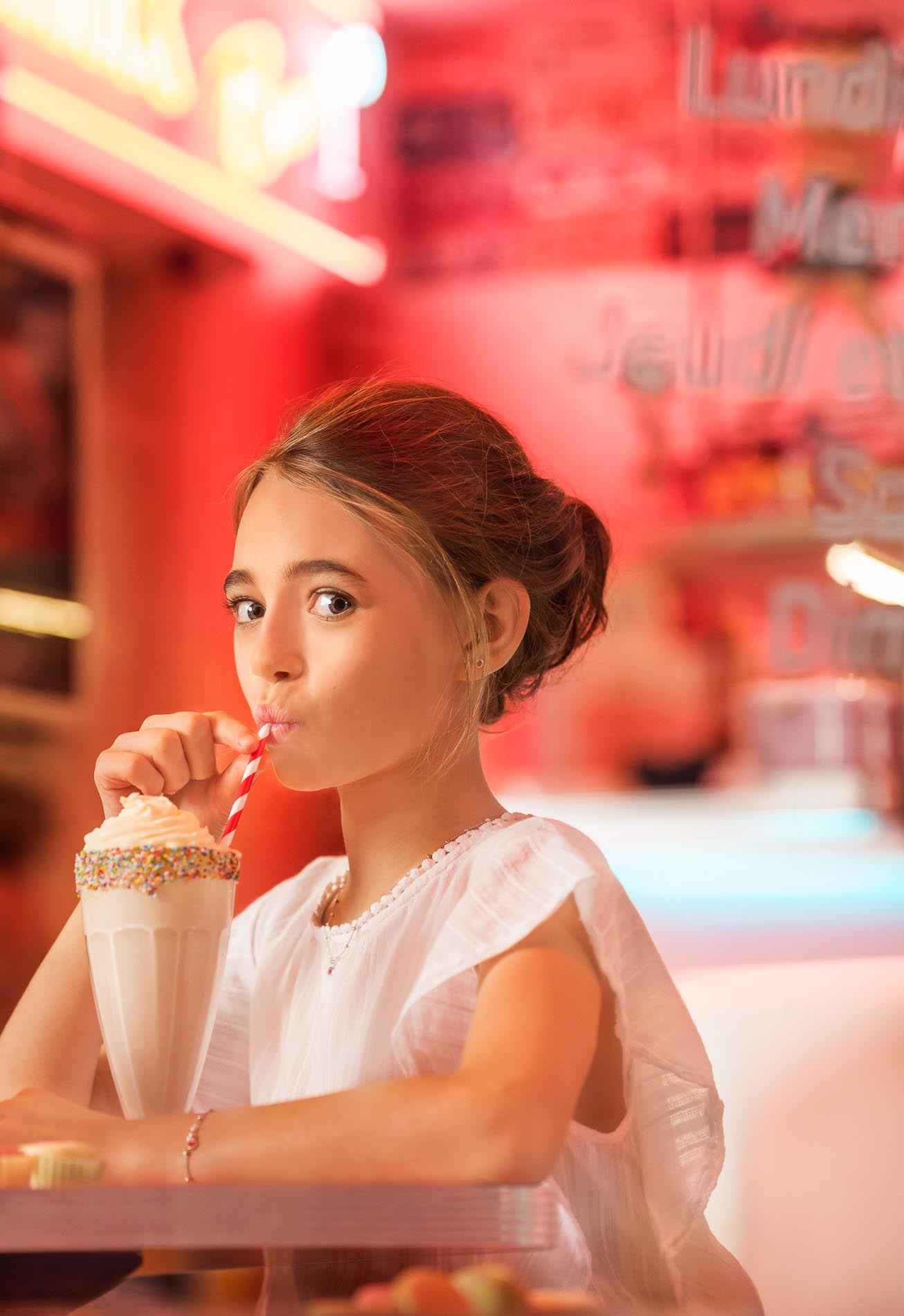 girl with a milkshake in a pink seventies bar