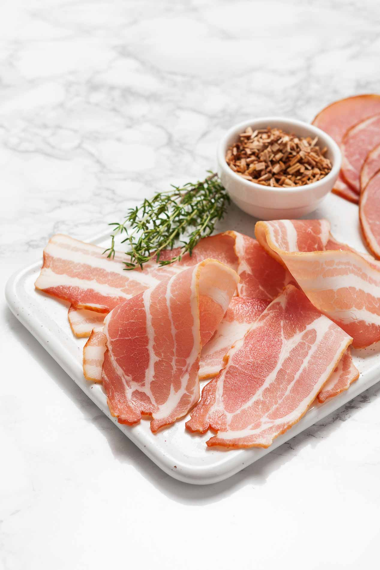 meat product sliced bacon on a chopping board