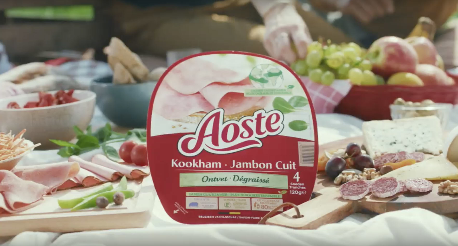 package of Aoste ham on a picnic blanket in the park