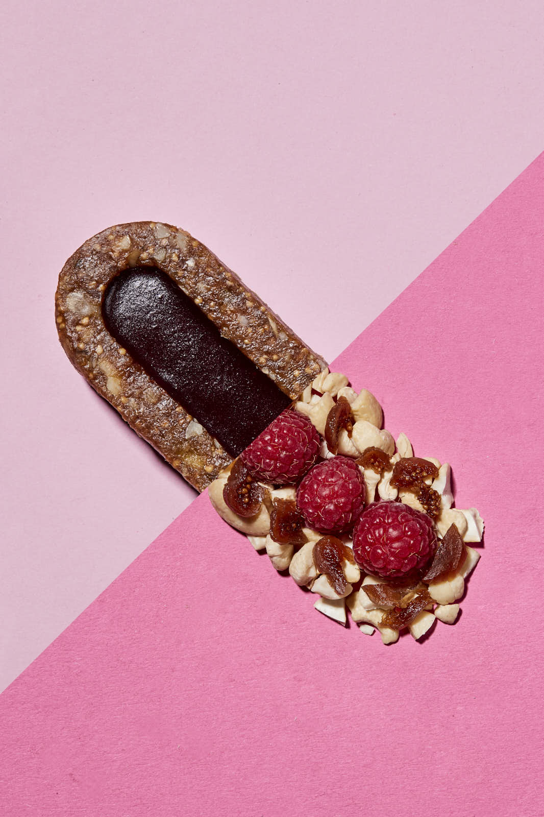 creative geometric pink food photography of a Bunch bar with raspberry flavour