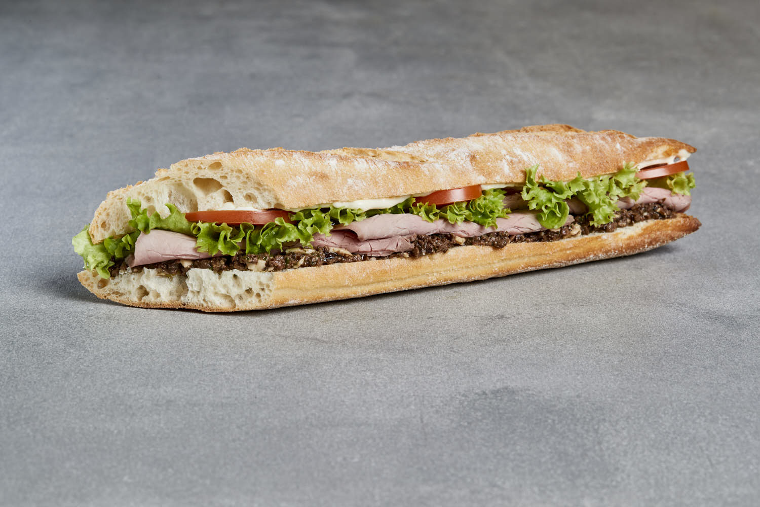 packshot of sandwich on a grey concrete background