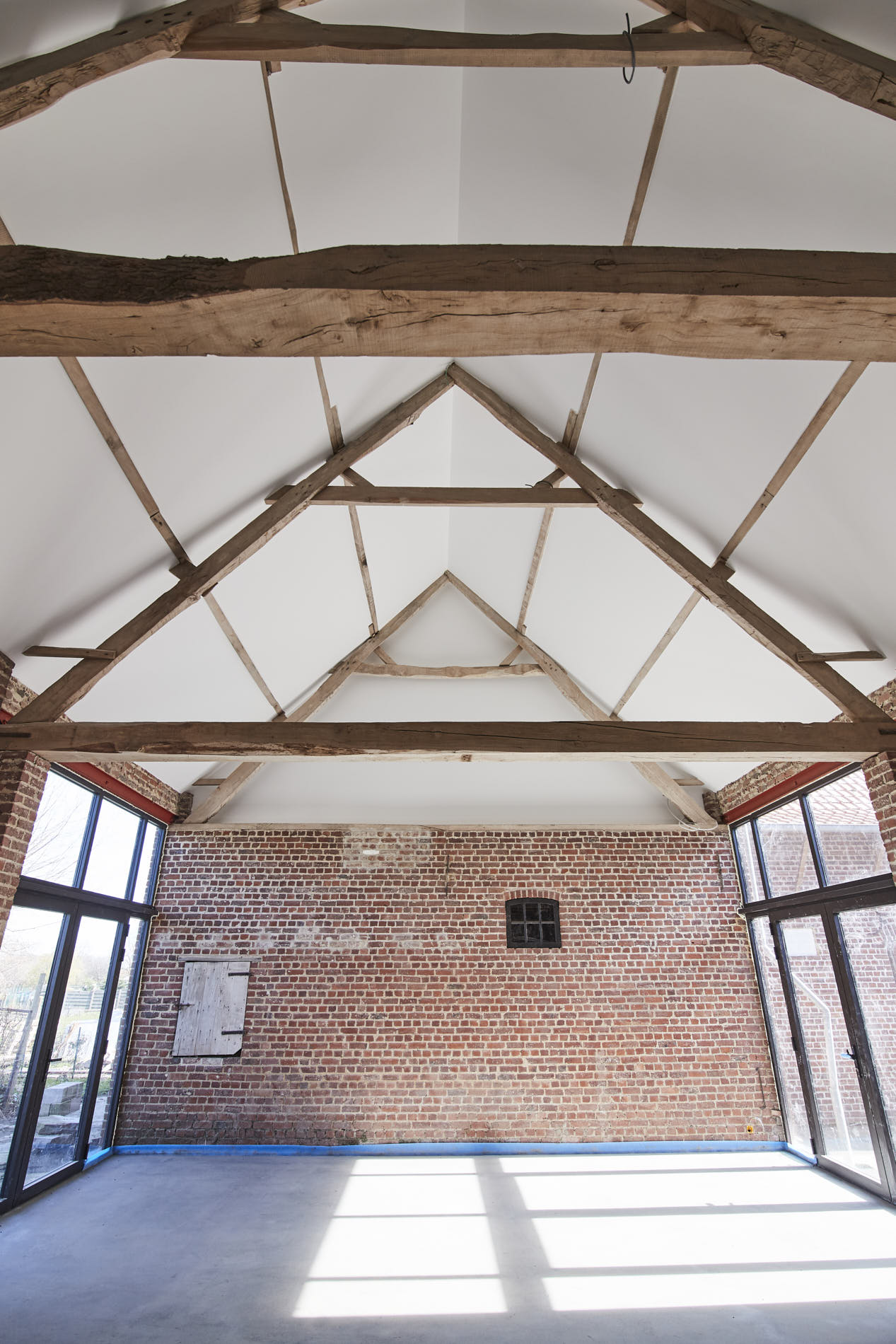 photostudio with wood roof structure and large windows