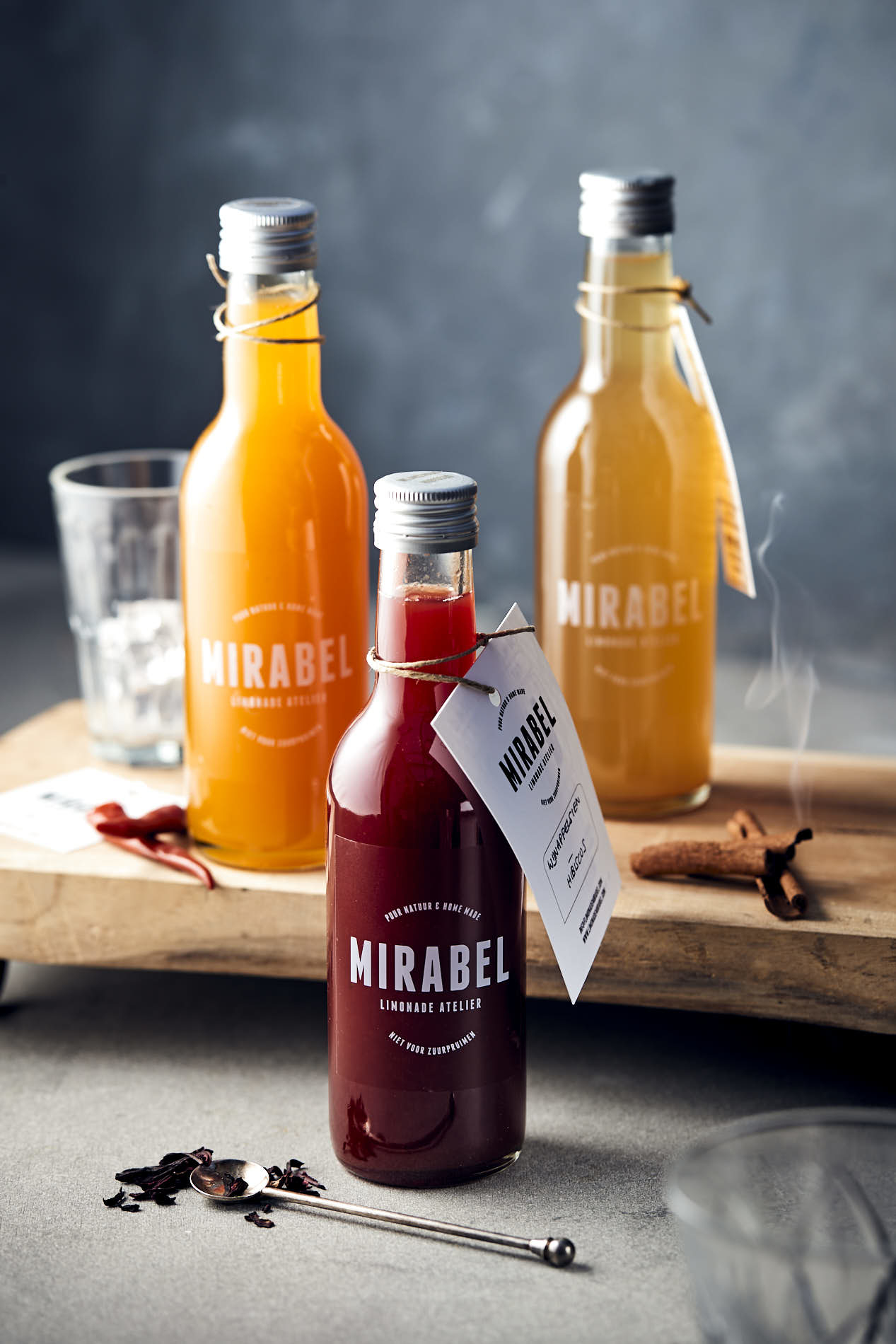 food photo by French Beans of three bottles Mirabel syrup in a cosy setting