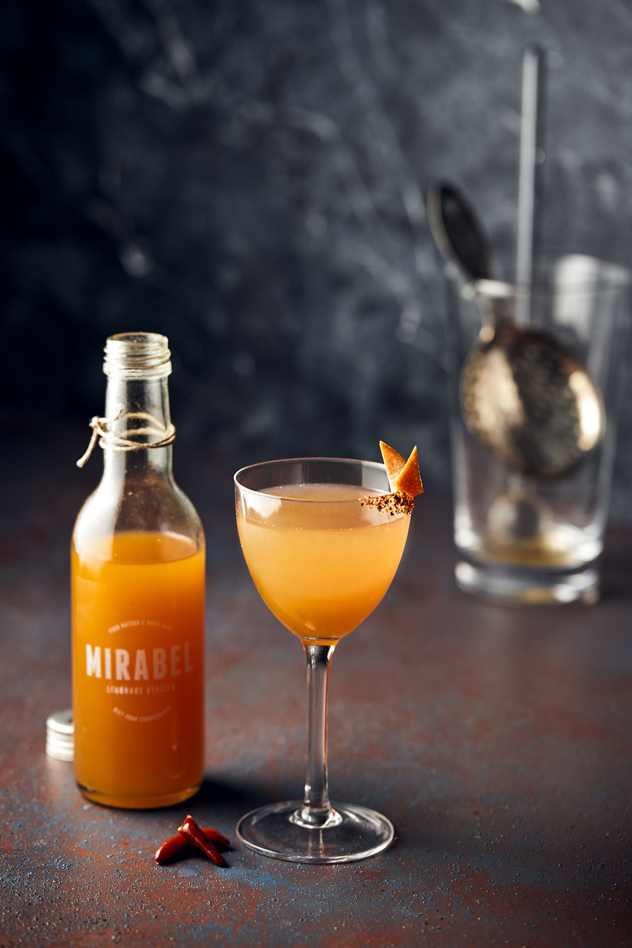 beverage photo of cocktail with Mirabel mandarin-chilli syrup in a nick&nora glass