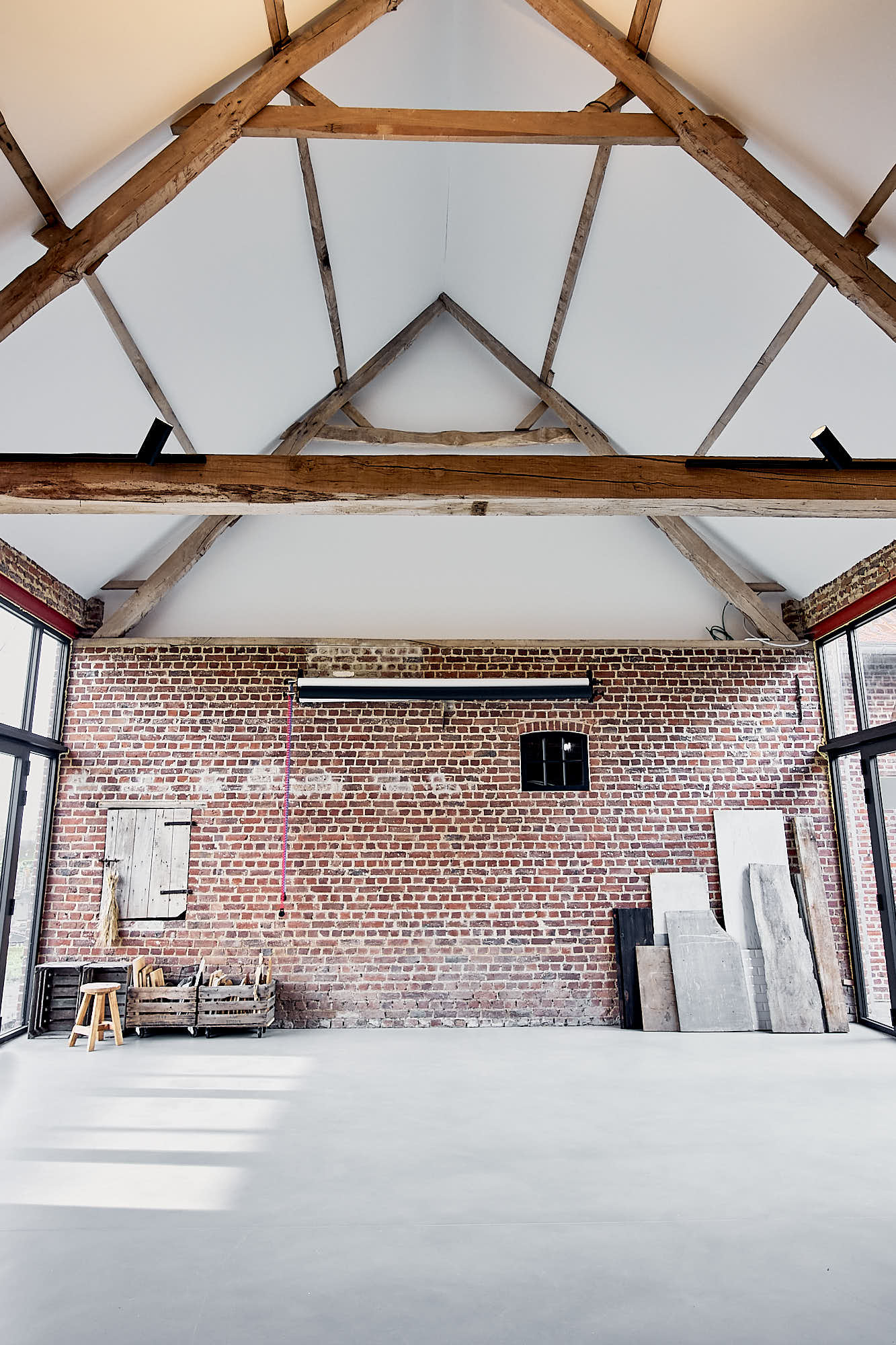 photography studio with high ceiling and brick walls